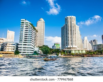 Business district cityscape from Chao Phraya River in Bangkok Thailand.