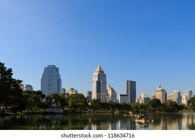 Business district cityscape from a park with blue sky