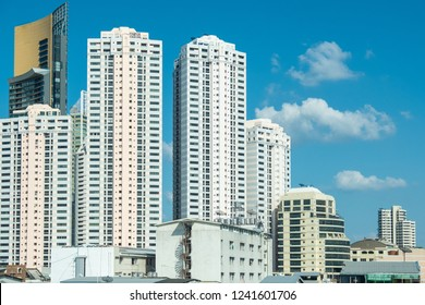 Business district with high building at sunshine day in Bangkok. Condominium in Bangkok city downtown with blue sky.