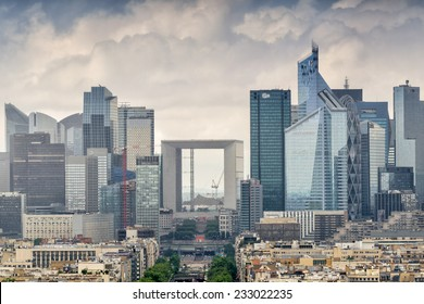 Business district of Paris. La Defense, aerial view on a cloudy day.