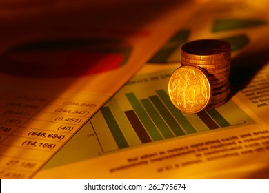 Business documents with coins