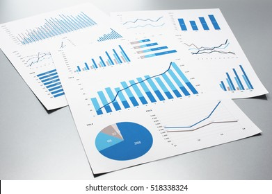 Business documents. Graphs and charts. Documents on gray reflection background.