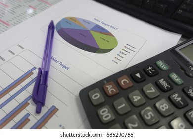Business documents with numbers and charts, office supplies at workplace, calculator
