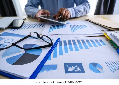 business documents on office  graph financial with social network diagram discussing data analysis data the charts and graphs