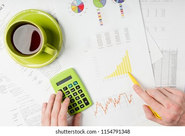 business documents on office table with diagram and man working