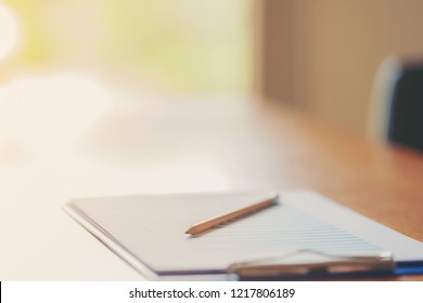 business documents on office table with laptop computer and grap