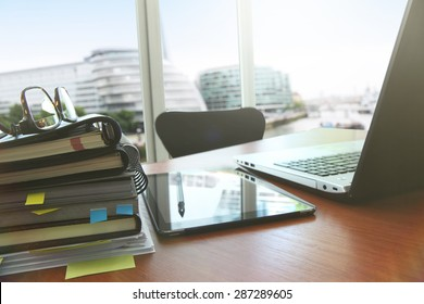 business documents on office table with smart phone and digital tablet as work space business with social network diagram concept