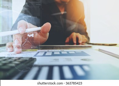 business documents on office table with digital tablet computer with smart phone and graph diagram and businessman working in the background