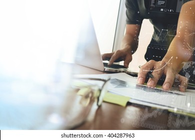 business documents on office table with smart phone and digital tablet and graph finance with social network diagram and man working in the background