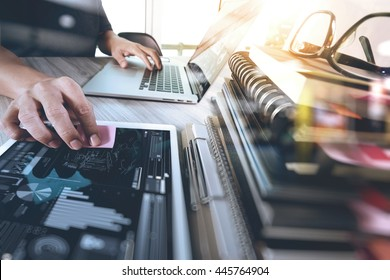 business documents on office table with smart phone and digital tablet and graph with social network diagram and man working in the background
