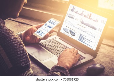 business documents on office table with smart phone and laptop computer and graph financial with social network diagram