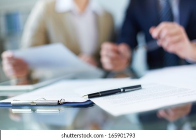 Business documents and pen at workplace