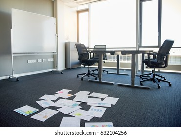 Business documents scattered on empty office floor
