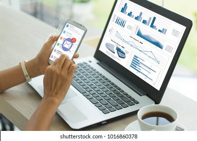 business documents  with smart phone and laptop computer and graph financial with social network diagram