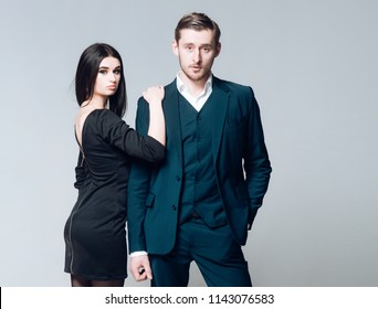 Business dress code. Man successful looks sharp well groomed in classic formal suit. Lady wear formal black dress. Business people choose high quality clothing. Stylish appearance pledge of success.