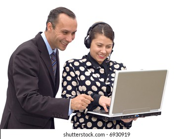 business duo looking happy to discover good results on laptop