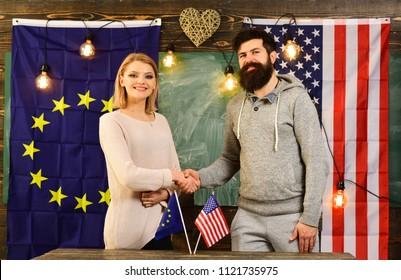 business economic partnership over a usa and eu flags