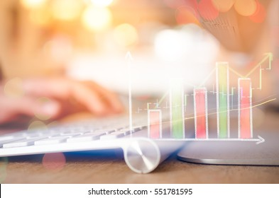 Business economic and technology working concept. Woman hand using mouse pc double exposure graph money stock trading up trend green arrow bokeh background. Vintage tone filter effect color style.