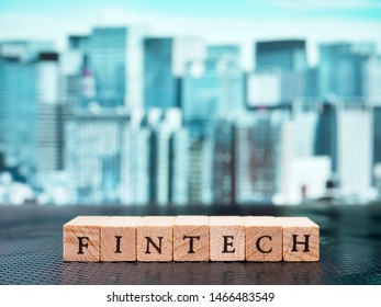 Business, economics and investment concept. Fintech character against a background of skyscrapers.