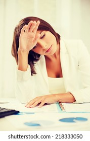 business and education concept - bored and tired woman with documents