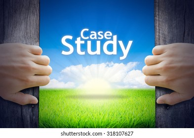 """Business and Education Concept """"Case Study"""". Hands opening a wooden door then found a texts floating among new world as green grass field, Blue sky and the Sunrise."""