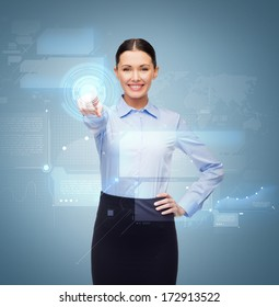 business and education concept - friendly young smiling businesswoman pointing to button