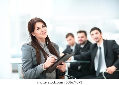 business and education concept - friendly young smiling businesswoman