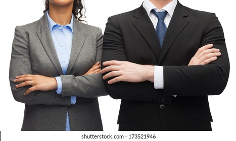 business and education concept - smiling businesswoman and businessman with crossed arms