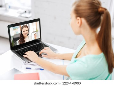 business, education and technology concept - woman or student having video call with customer service operator or teacher on laptop computer at home or office