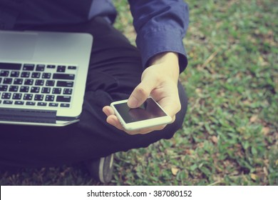 business employee man hand text smartphone and laptop.