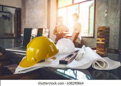 Business engineer contractor who contracts to supplies consulting about working their job at construction site office headquarters.