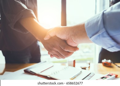 Business engineer team shaking hands to agree to joint business agreements in the future. About the creation of real estate and housing projects for government projects.