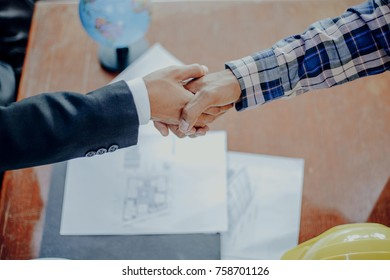 Business with engineering people shaking hands, finishing up a meeting Handshake Business concept