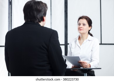 business enthusiastic woman interviewing a man for a job