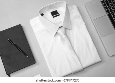 Business equipment, shirt, laptop and notebook perspective view, isolated