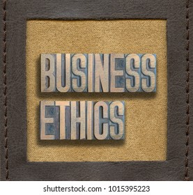 business ethics phrase assembled from vintage wooden letterpress inside stitched leather frame