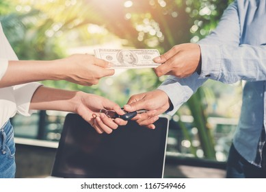 Business exchange with money and keys car. Dealing and Car Loans concept.