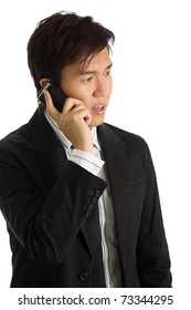 Business executive in corporate setting on phone