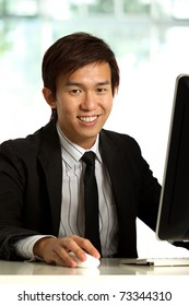 Business executive in corporate setting working at a desk