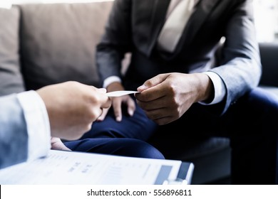 business executive exchanging business card