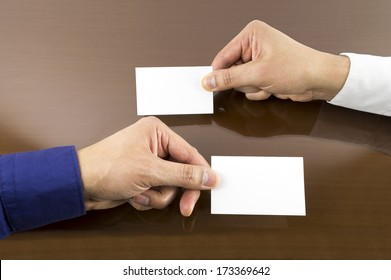business executive exchanging business card on the table