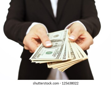 Business executive in formal suit giving money as a bribe