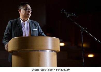 Business executive giving a speech at conference center