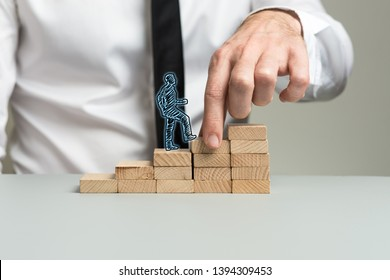 Business executive making wooden steps for a silhouetted businessman to walk upwards in his career.