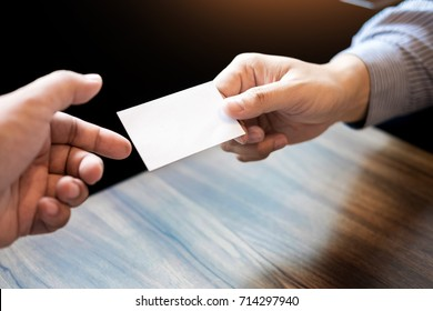 Business executive man exchanging business card for start good connection with partner.