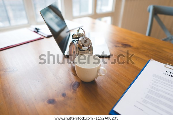 Business executive office Desk Background concept.Business computer empty office table with desktop laptop,notebook,clock,pen and annual,summary report,document and paper,working space at home.