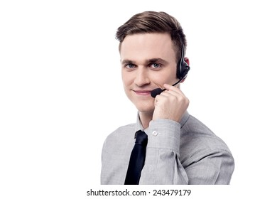 Business executive talking over his headphones over white