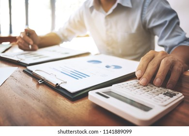 business executive working with financial report