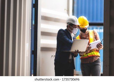 Business executives and engineers wear medical face masks. While inspecting industrial plants and warehouses for international shipping businesses Concepts of import and export via airplanes and ships