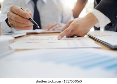 Business executives make a conversation with documents in office.